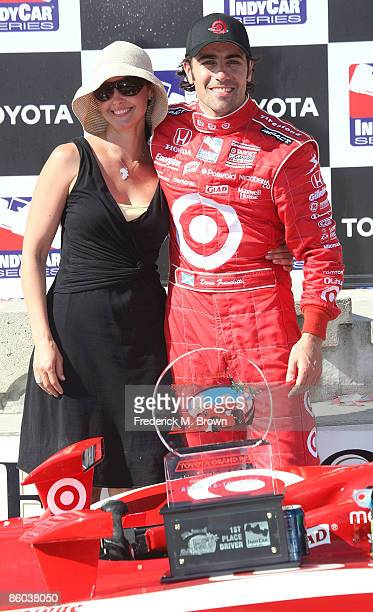 Actress Ashley Judd and driver Dario Franchitti in the winner's circle at the 35th annual Toyota Grand Prix of Long Beach on April 19 2009 in Long...