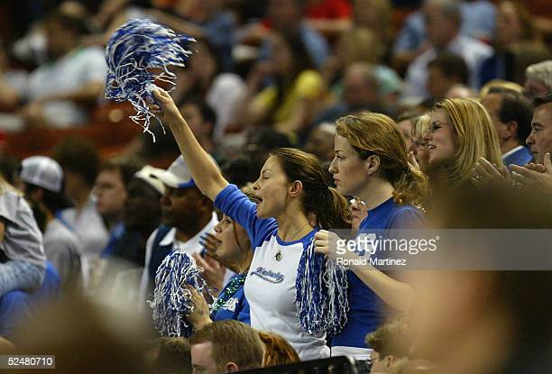 Actress Ashley Judd and her friend Jenny McGrath cheer on the Kentucky Wildcats during the 2005 NCAA division 1 men's basketball championship...
