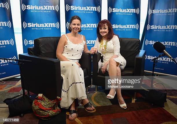 Actress Ashley Judd and mother singer Naomi Judd pose following the launch of Naomi's SiriusXM series 'Think Twice' at SiriusXM Music City Theater at...