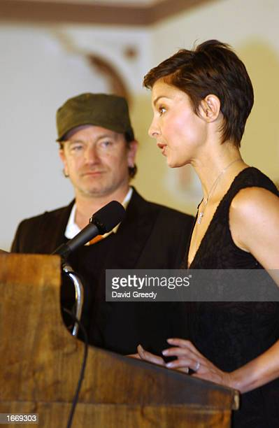 Actress Ashley Judd and U2 singer Bono speak out during the Heart of America AIDS awareness tour on December 2, 2002 at the University of Iowa in...