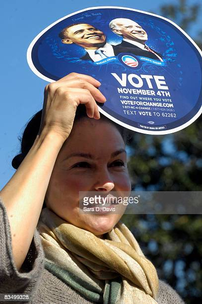 Actress Ashley Judd blocks the sun with a campaign sign at a rally for Democratic presidential candidate Barack Obama at the University of North...