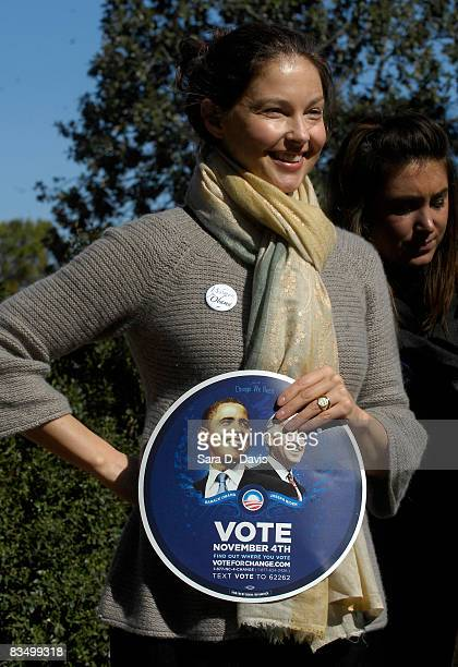 Actress Ashley Judd holds a campaign sign for Democratic presidential candidate Barack Obama during a rally at the University of North Carolina on...