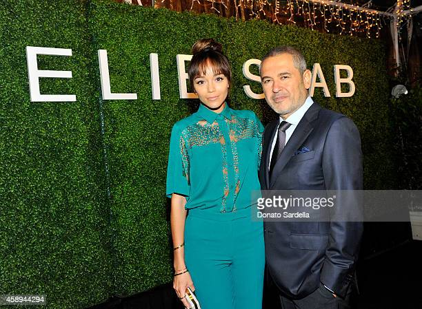 Actress Ashley Madekwe and designer Elie Saab attend a private Elie Saab dinner on November 13 2014 in Los Angeles California #ElieSaabLA