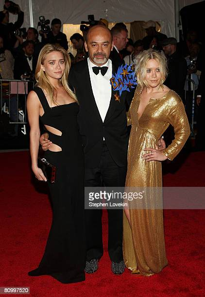 Actress Ashley Olsen, designer Christian Louboutin, and actress Mary Kate Olsen arrive at the Metropolitan Museum of Art Costume Institute Gala,...