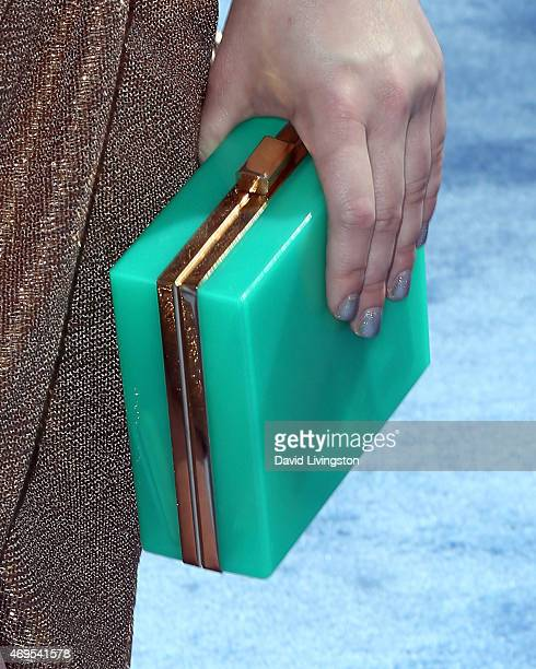 Actress Ashley Rickards purse detail attends the 2015 MTV Movie Awards at the Nokia Theatre LA Live on April 12 2015 in Los Angeles California