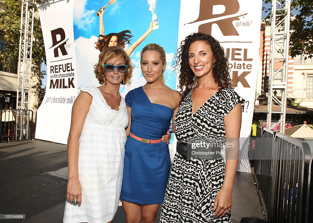 Actress Ashley Tisdale (C) poses on stage with Miranda Abney of MilkPEP (L) and American Cheerleader Magazine Editor-in-chief Marisa Walker (R) during the 'Be Strong' Challenge with Ashley Tisdale held at The Grove on August 30, 2011 in Los Angeles, California.