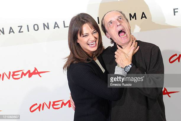 Actress Asia Argento and her father director Dario Argento attend the photo call for 'La Terza Madre' during the 2nd Rome Festival October 24 2007 in...
