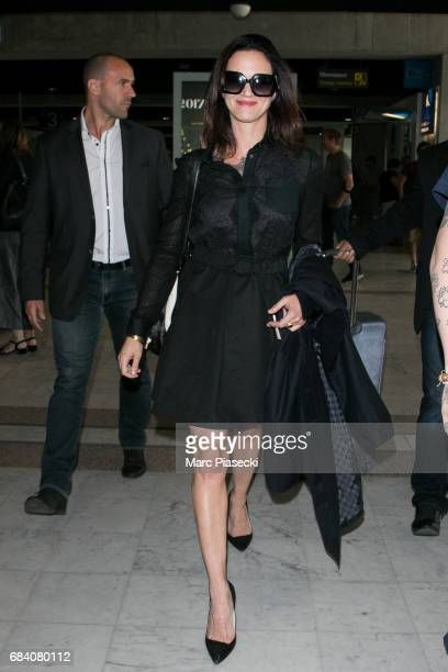 Actress Asia Argento arrives at Nice airport during the 70th annual Cannes Film Festival at on May 17 2017 in Cannes France