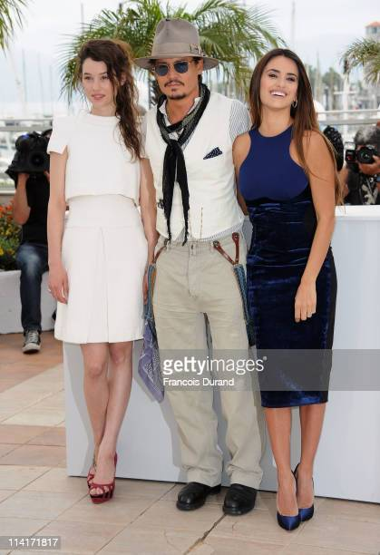 """Actress Astrid Berges-Frisbey, actor Johnny Depp, actress Penelope Cruz attend the """"Pirates of the Caribbean: On Stranger Tides"""" photocall at the..."""