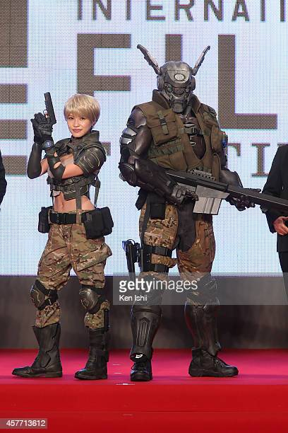 Actress Asuka Kishi and cartoon character pose for 'Appleseed Alpha' photocall during the opening ceremony during the 27th Tokyo International Film...