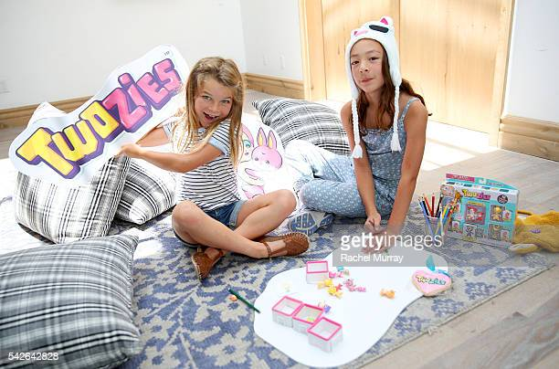 Actress Aubrey AndersonEmmons and friend Raegan Revord decorate their DIY shadow boxes as they preview Twozies a new toy line from the makers of...