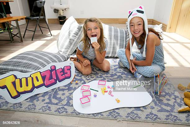 Actress Aubrey AndersonEmmons and friend Raegan Revord preview Twozies a new toy line from the makers of Shopkins at AU FUDGE on June 22 2016 in West...