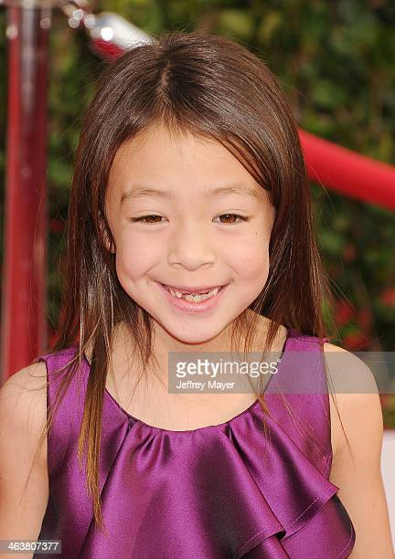 Actress Aubrey AndersonEmmons arrives at the 20th Annual Screen Actors Guild Awards at The Shrine Auditorium on January 18 2014 in Los Angeles...