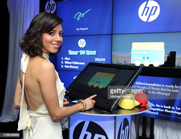 Actress Aubrey Plaza poses with HP in the HP Touchsmart Gift Lounge backstage at the Nokia Theatre in celebration of The 63rd Primetime Emmy Awards...