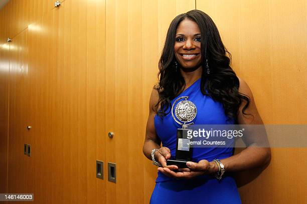 Actress Audra McDonald poses in the 66th Annual Tony Awards press room at The Beacon Theatre on June 10 2012 in New York City