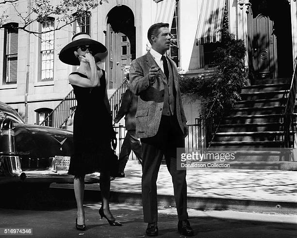 Actress Audrey Hepburn and actor George Peppard pose for a publicity still for the Paramount Pictures film 'Breakfast at Tiffany's' in 1961 in New...