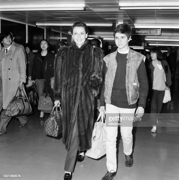 Actress Audrey Hepburn and her son Luca Dotti at an airport. April 1984.