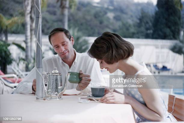 Actress Audrey Hepburn and husband actor Mel Ferrer pose for a photo at the Bel Air Hotel on March 27 1957 in Los Angeles California