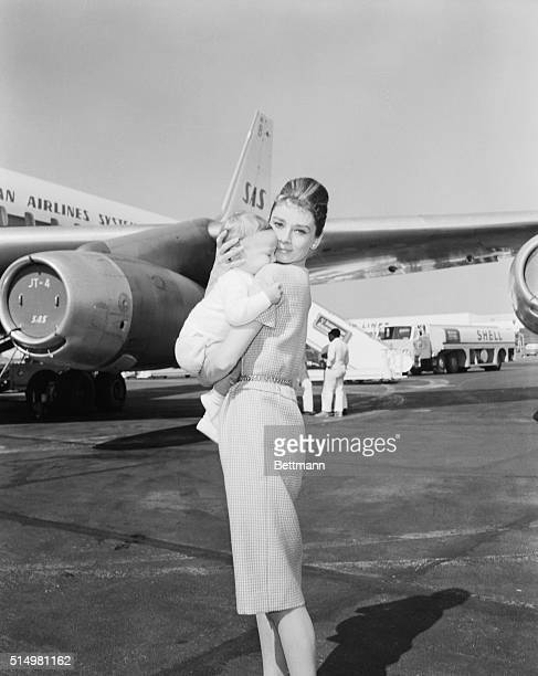 Actress Audrey Hepburn and son Sean, 7 months, leave for Rome via jetliner. She eventually was to join husband Mel Ferrer in Yugoslavia.