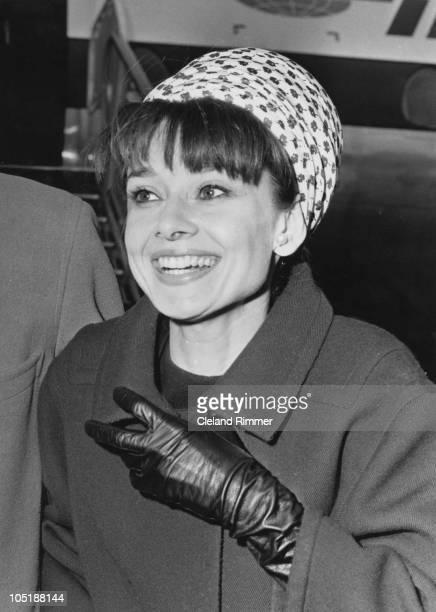 Actress Audrey Hepburn arrives at London Airport, April 1964.