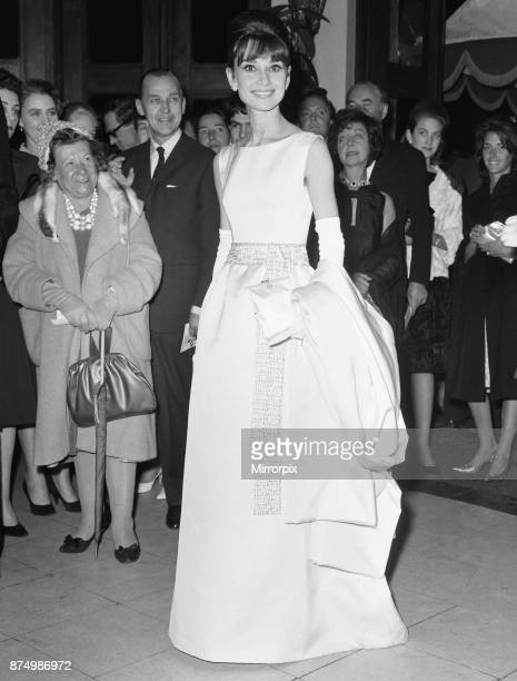 Actress Audrey Hepburn arrives at the London premiere of her latest movie 'Breakfast At Tiffany's' at the Plaza Theatre watched by an admiring crowd...