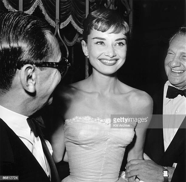 Actress Audrey Hepburn attending a benefit premiere of �Roman Holiday� with William Wyler the producerdirector of Paramount's �Roman Holiday�...