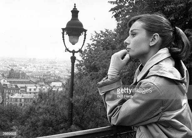 Actress Audrey Hepburn contemplates Paris where she is filming her first musical 'Funny Face' with Fred Astaire Picture Post 8540 Audrey Dances With...