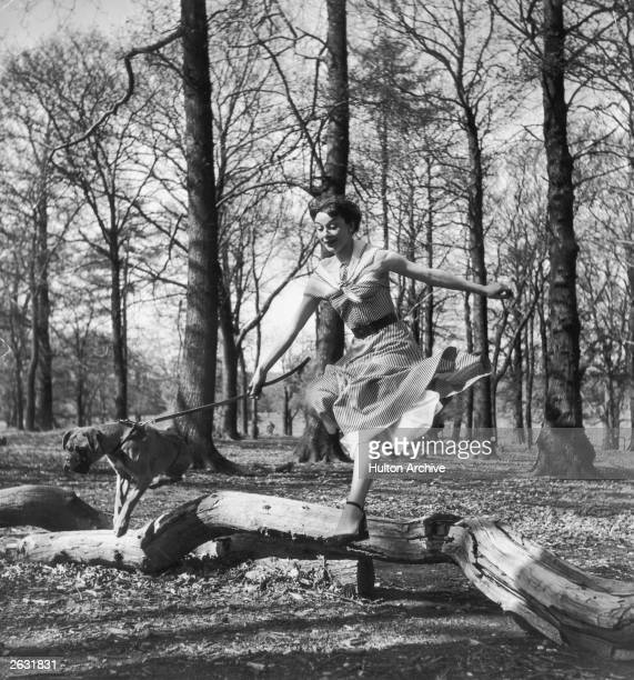 Actress Audrey Hepburn excercising her dog in Richmond Park after a strenuous season in the London revue 'Sauce Piquante' 13th May 1950 Picture Post...