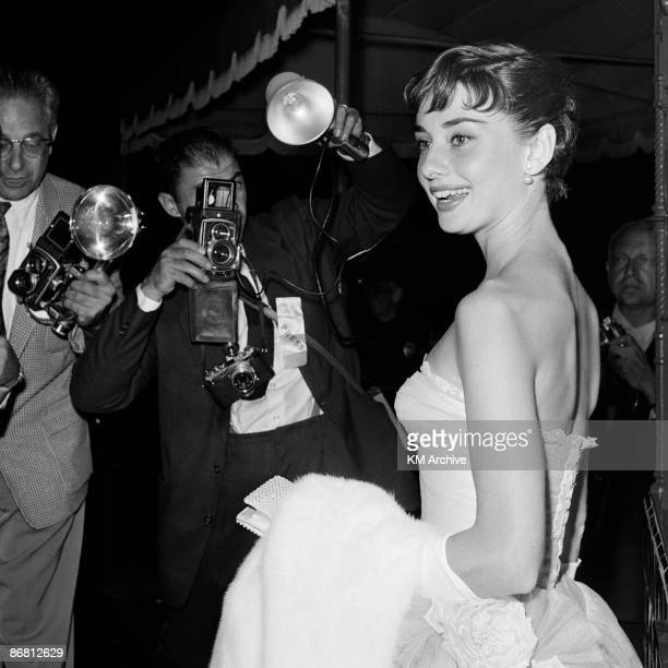 Actress Audrey Hepburn faces the cameras while attending a benefit premiere of Roman Holiday Westwood CA 1953