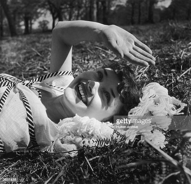 Actress Audrey Hepburn relaxes in Richmond Park after a strenuous season in the London revue 'Sauce Piquante' 13th May 1950 Picture Post 5035 We Take...