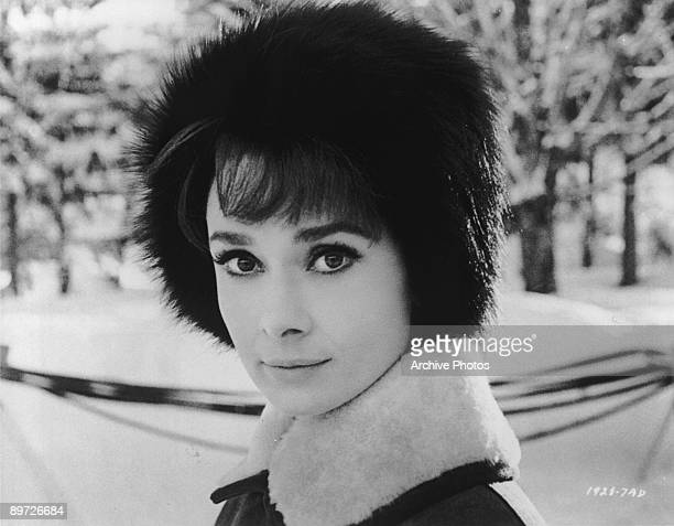 Actress Audrey Hepburn wearing a fur hat in a scene from 'Charade' directed by Stanley Donen 1963
