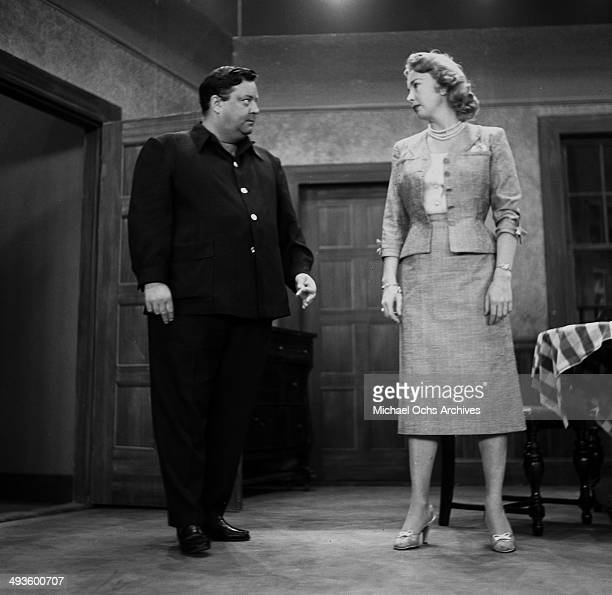 Actress Audrey Meadows and actor Jackie Gleason on stage during the rehearsal of the 'The Jackie Gleason Show' in Los Angeles California