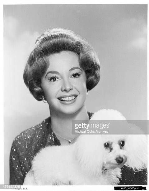 Actress Audrey Meadows poses with a dog for the movie 'Take Her She's Mine' circa 1963