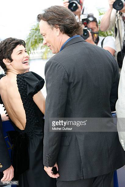 """Actress Audrey Tautou and actor Tom Hanks attend a photocall for """"The Da Vinci Code"""" at the Palais during the 59th International Cannes Film Festival..."""