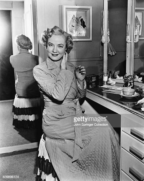 Actress Audrey Totter in her dressing room on the movie set prepares for her next scene with Clark Gable in MetroGoldwynMayer's Any Number Can Play