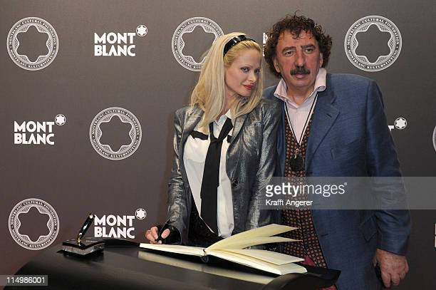 Actress Audrey Tritto and Monty Shadow pose during the Montblanc De La Culture Arts Patronage Award 2011 at the Deichtorhallen on May 31 2011 in...