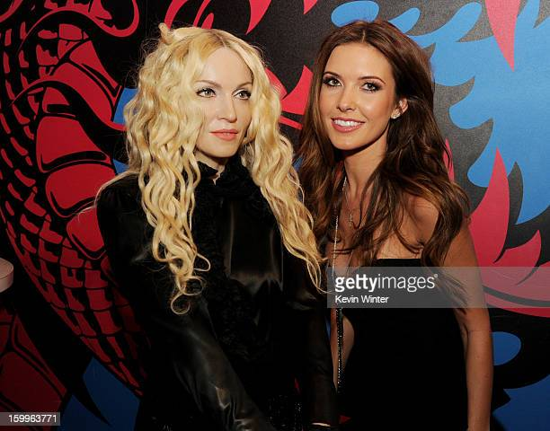 Actress Audrina Patridge poses with a wax figure of Madonna at the after party for the premiere of Relativity Media's 'Movie 43' at Madame Tussaud's...