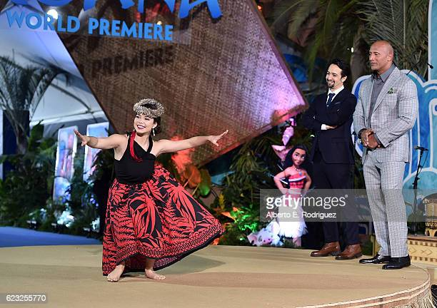 Actress Auli'i Cravalho performs onstage with songwriter LinManuel Miranda and actor Dwayne Johnson at The World Premiere of Disney's 'MOANA' at the...