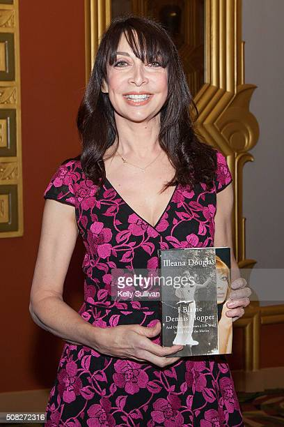 Actress author producer and director Illeana Douglas poses for a photo with her book 'I Blame Dennis Hopper' at the Alamo Drafthouse prior to a...