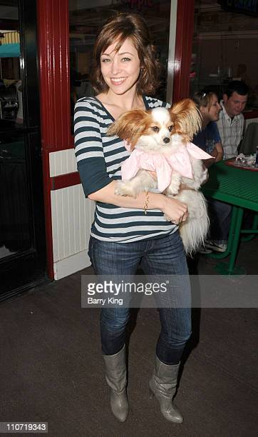 Actress Autumn Reeser and her dog Gatsby attend Pink's Grand Opening at Knott's Berry Farm on February 28 2010 in Buena Park California