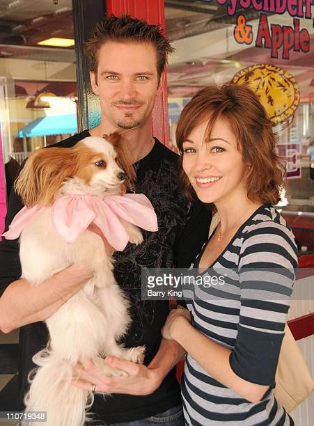 Actress Autumn Reeser and husband Jesse Warren and their dog Gatsby attend Pink's Grand Opening at Knott's Berry Farm on February 28 2010 in Buena...