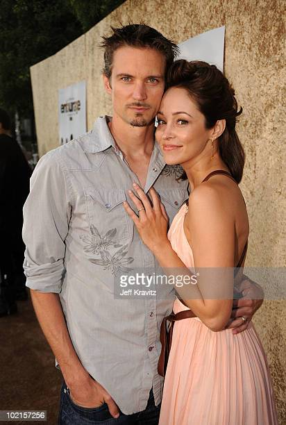 Actress Autumn Reeser and husband Jesse Warren arrive at HBO's Entourage Season 7 premiere held at Paramount Theater on the Paramount Studios lot on...