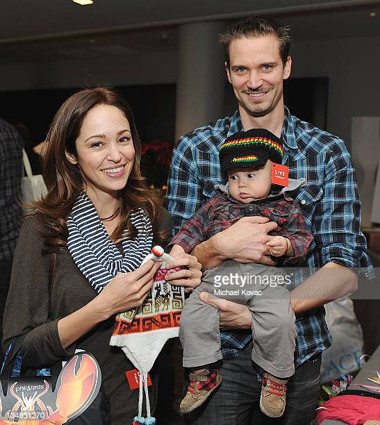Actress Autumn Reeser husband Jesse Warren and son Finn attend the Working Elves' First Annual Santa's Secret Workshop Benefitting LA Family Housing...