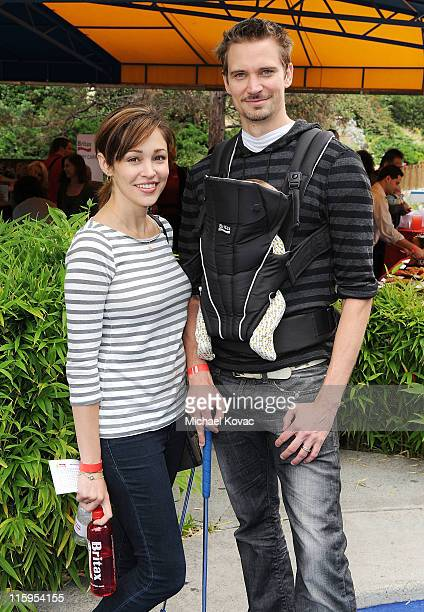 Actress Autumn Reeser husband Jesse Warren and their son Finn attend Britax and Baby Buggy host PreFather's Day Mini Golf Open to Celebrate the...