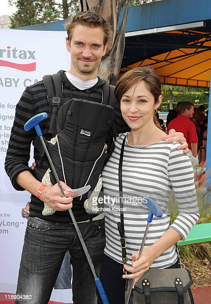 Actress Autumn Reeser husband Jesse Warren and their son Finn Warren attend Britax and Baby Buggy host PreFather's Day Mini Golf Open to Celebrate...