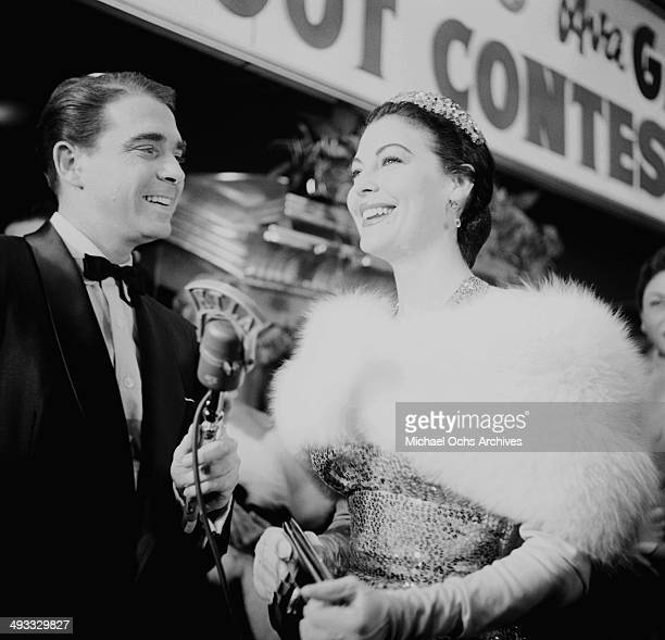 Actress Ava Gardner with Army Archerd attends the premiere of The Barefoot Contessa in Los Angeles California