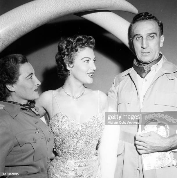Actress Ava Gardner with Mr and Mrs Frank BunnyAllen the African White Hunter attends the premiere of Mogambo in Los Angeles California