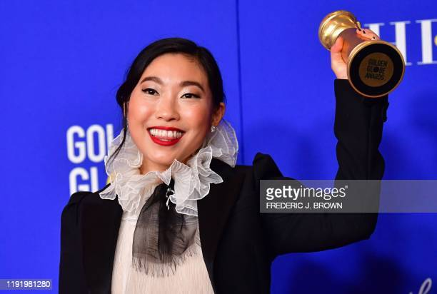 TOPSHOT US actress Awkwafina poses in the press room with the award for Best Performance by an Actress in a Motion Picture Musical or Comedy during...
