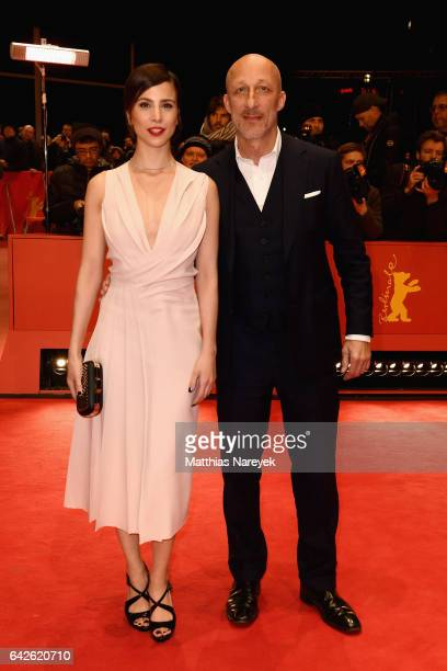 Actress Aylin Tezel wearing Boss and film director Oliver Hirschbiegel arrive for the closing ceremony of the 67th Berlinale International Film...