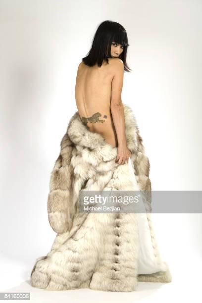 LOS ANGELES CA DECEMBER 22 Actress Bai Ling poses at the Bai Ling Studio Shoot wearing jewelry by Hye Angel Design and dress by Tal on December 22...